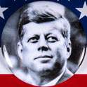 Kennedy campaign button on flag background