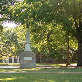 The Maxcy monument stands left of center on the historic Horseshoe, which is green with summer