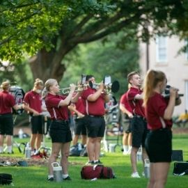 The Carolina Band playing on the horseshoe in a socially distant manner